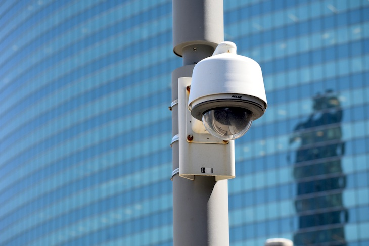 A police surveillance camera monitors the bridge walkway near Wacker and Lake Streets in Chicago, Illinois