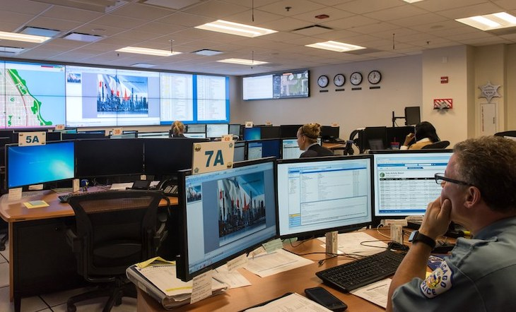 Personnel in Chicago Police Department's Crime Prevention and Information Center monitor surveillance video from around the city.